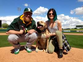 A's pitcher Sean Doolittle, Stella, and Eireann Dolan.