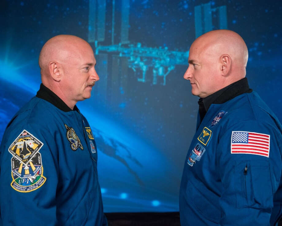 During the year Scott Kelly, right, spends in space, NASA will use his twin brother Mark, who will be earthbound in Houston, as a control. Scientists will compare the way their bodies change over the course of a year. Photo: Washington Post / THE WASHINGTON POST