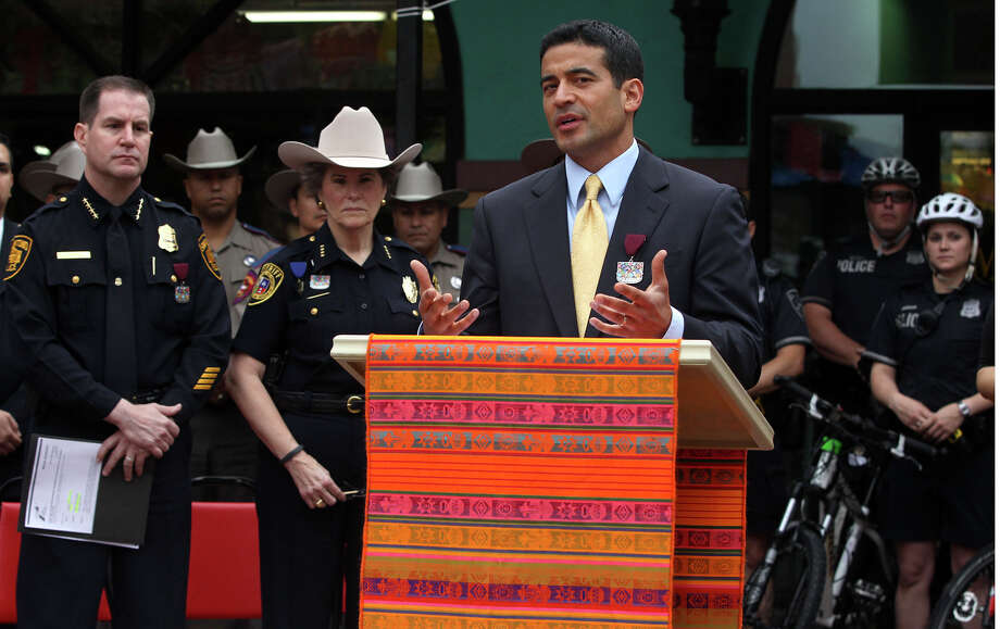 Bexar County District Attorney Nico LaHood (at lectern) speaks Monday March 30, 2015 during a conference held at Market Square to announce the 2015 FIESTA P.A.S.S. Campaign. The Texas Department of Transportation along with area law enforcement agencies are encouraging those who attend Fiesta to designate a driver who has had no alcohol. P.A.S.S. stands for Person Appointed to Stay Sober. On the left is Anthony Trevino, Interim Chief of the San Antonio Police Department and between Trevino and LaHood is Sheriff Susan Pamerleau (wearing hat) of the Bexar County Sheriff's Office. Photo: John Davenport, Staff / San Antonio Express-News / ©San Antonio Express-News/John Davenport
