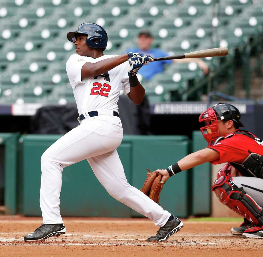 Ke'Bryan Hayes, left, played for the USA under-18 national team at the 2014 COPABE Pan-American Championships in Mexico. Hayes, who signed to play baseball at Tennessee, is batting .500 for Concordia Lutheran this season. Photo: Karen Warren, Staff / © 2014 Houston Chronicle