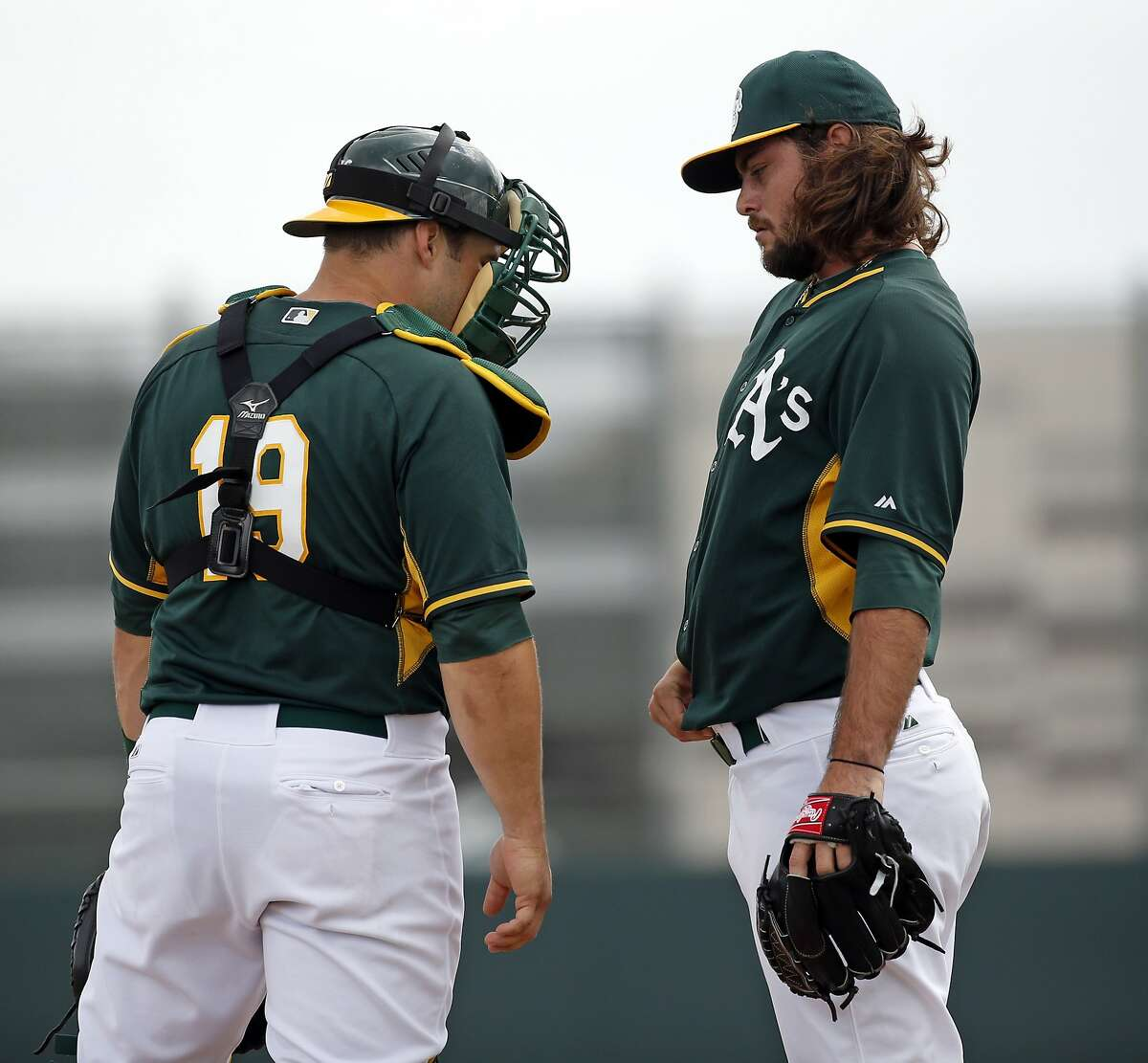 Oakland A' s R.J. Alvarez and Josh Phegley during intrasquad game at Spring Training at Fitch Park in Mesa, Arizona, on Saturday, February 28, 2015.