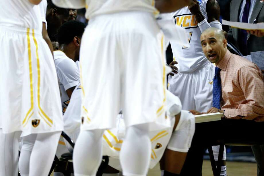 Head coach Shaka Smart of the Virginia Commonwealth Rams huddles up with his players against the Ohio State Buckeyes in the first half during the second round of the NCAA tournament at Portland, Ore. Photo: Jonathan Ferrey /Getty Images / 2015 Getty Images
