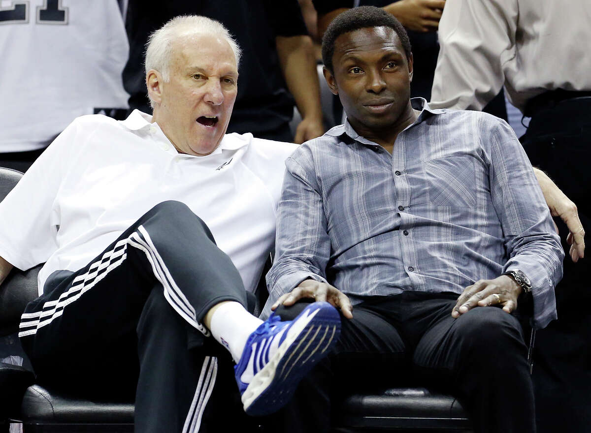 Spurs head coach Gregg Popovich (left) talks with former Spurs player Avery Johnson during an open scrimmage held Sunday Oct. 6 2013 at the AT&T Center.