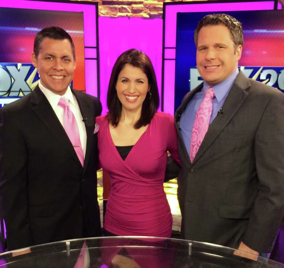 KABB's former morning team: The departing Monica Taylor is flanked by co-anchor Ernie Zuniga and weatherman Shaun Stevens.