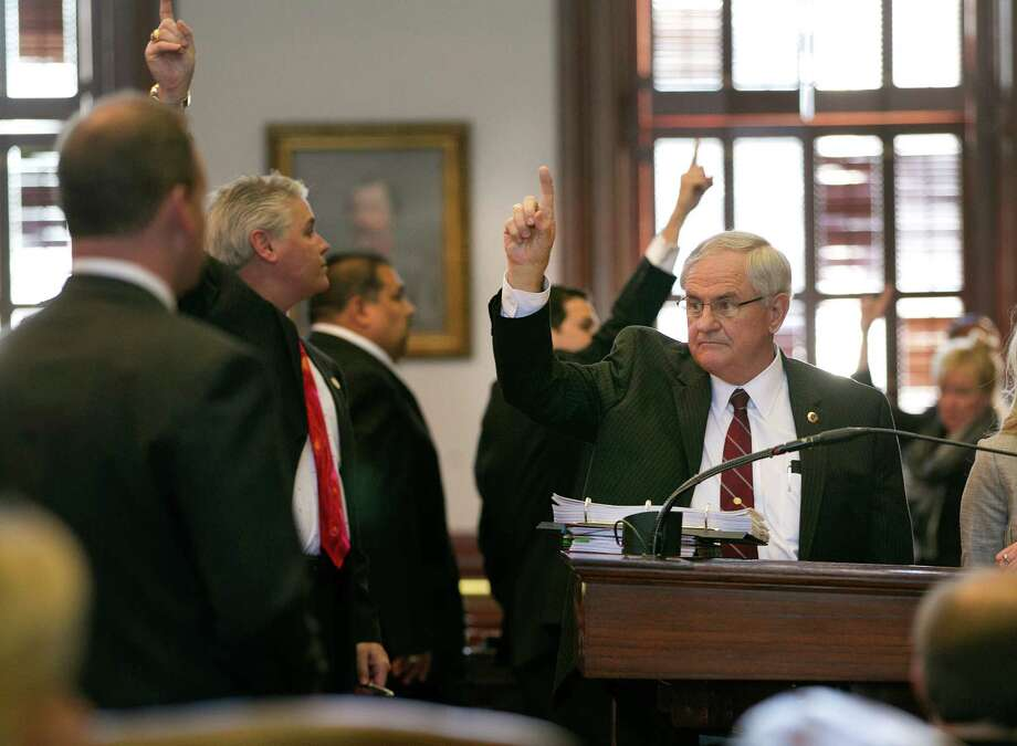 Legislators, including Rep. Jimmie Don Aycock, right, raise a hand to vote on an amendment on the House floor at the Capitol during a 2013 debate. Aycock is demonstrating true leadership on education funding this year. Photo: Deborah Cannon /Associated Press / Austin American-Statesman