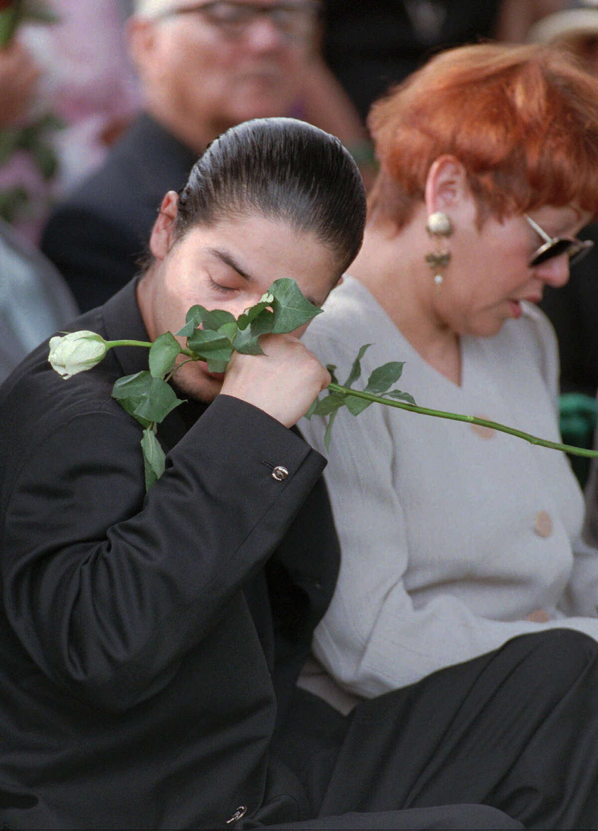 Chris Perez, the husband of slain Tejano star Selena, wipes a tear away from his eye during her funeral in Corpus Christi April 3, 1995. Next to him his Selena's mother, Marcella Quintanilla. Photo by David J. Phillip/pool