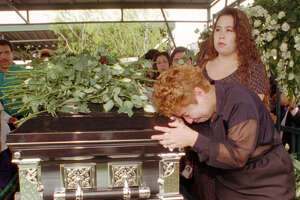 Lidia Castaneda weeps over the coffing of slain Tejano music star Selena during funeral services Monday, April 3, 1995, in Corpus Christi, Texas. Selena was fatally shot Friday at a Corpus Christi motel. (AP Photo/David J. Phillip, Pool)