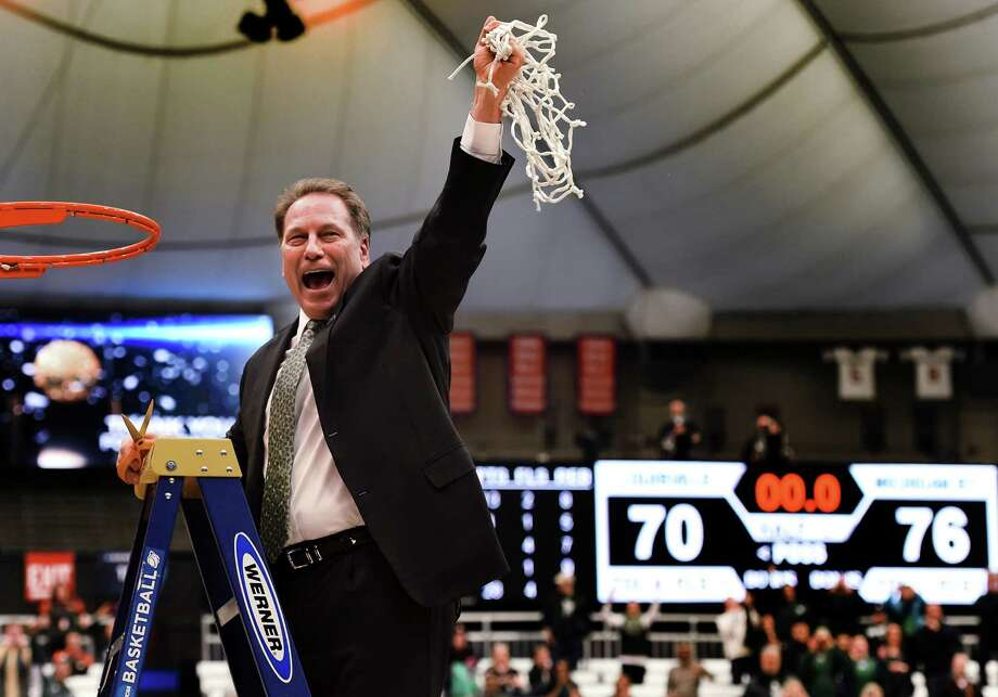 Coach Tom Izzo was having a twine time Sunday after Michigan State beat Louisville to secure the Spartans' seventh Final Four trip under Izzo. Photo: Kevin Rivoli, MBR / Post-Standard