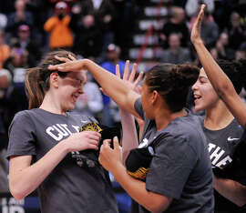 Connecticut's Breanna Stewart (left), who had 23 points and 16 rebounds, celebrates with teammates after the Huskies' win.