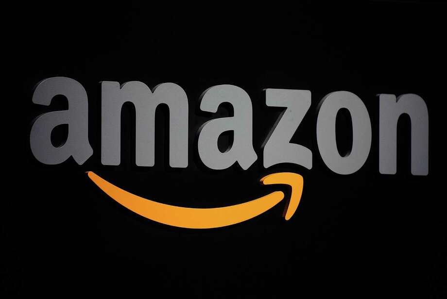 (FILES) This September 28, 2011 file photo shows the Amazon logo during a press conference in New York. US online giant Amazon said March 30, 2015 it was launching a services marketplace offering to connect consumers with businesses offering anything from home improvement to piano lessons. Amazon Home Services, which is being launched in major cities across the United States, includes businesses in diverse areas such as gardening, computer repair, and math or yoga instruction. AFP PHOTO/EMMANUEL DUNAND / FILESEMMANUEL DUNAND/AFP/Getty Images Photo: EMMANUEL DUNAND, Staff / AFP