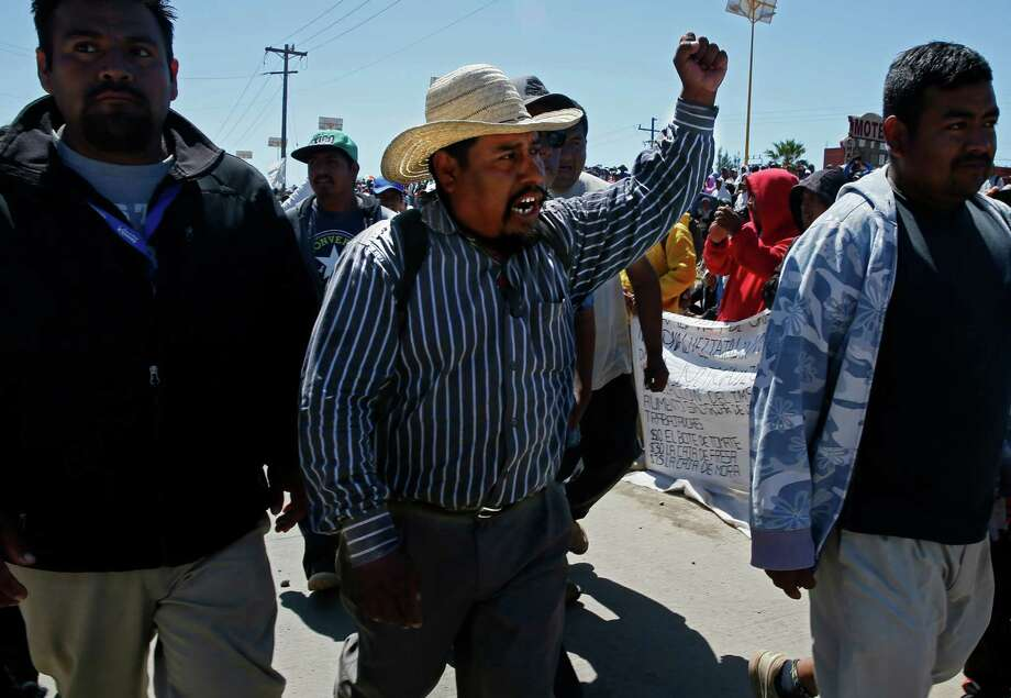 Farmworker leader Bonifacio Martinez revs up a crowd before a meeting with agribusiness bosses. Photo: Don Bartletti, MBR / Los Angeles Times