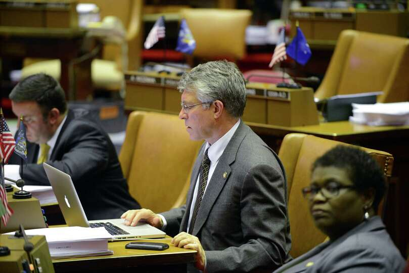 Assemblyman Phil Steck works on his laptop before the start of session Monday afternoon, March 30, 2