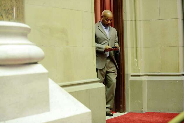 Assembly Speaker Carl Heastie checks his cellphone from his Assembly Chamber office doorway before the start of session Monday afternoon, March 30, 2015, at the Capitol in Albany, N.Y. (Will Waldron/Times Union) Photo: WW / 00031230A