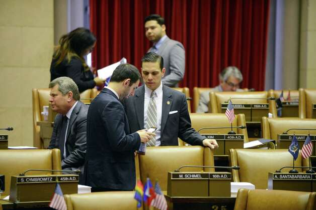 Assemblyman Angelo Santabarbara (D-Rotterdam), center,  confers with a colleague in the Assembly Chamber before the start of session Monday afternoon, March 30, 2015, at the Capitol in Albany, N.Y. (Will Waldron/Times Union) Photo: WW / 00031230A