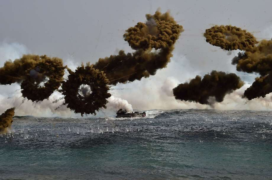 South Korean Marine amphibious assault vehicles fire smoke shells to land on the seashore during a joint landing operation by US and South Korean Marines in the southeastern port of Pohang on March 30, 2015. The drill is part of the annual joint exercise Foal Eagle to enhance the combat readiness of the US and South Korea supporting forces in defense of the Korean Peninsula. Photo: Jung Yeon-je, AFP / Getty Images