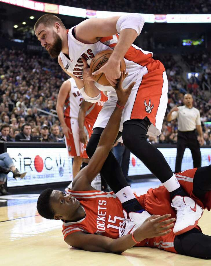 The Raptors' Jonas Valanciunas has Rockets rookie Clint Capela at his mercy during the first half Monday night. Capela had eight points in 19 minutes. Photo: Frank Gunn, SUB / The Canadian Press