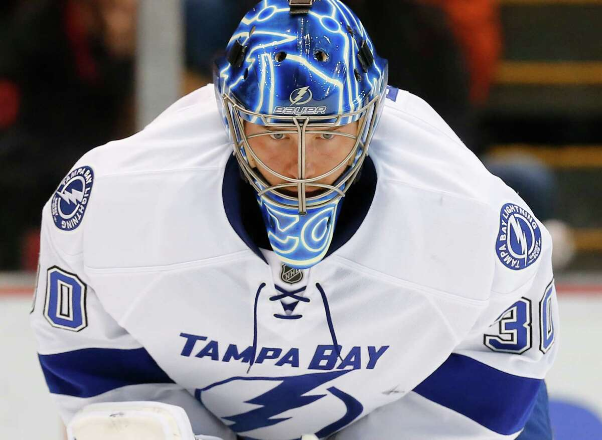 Tampa Bay Lightning goalie Ben Bishop looks at the ice after allowing a goal by Detroit Red Wings' Gustav Nyquist in the second period of an NHL hockey game in Detroit, Saturday, March 28, 2015. (AP Photo/Paul Sancya) ORG XMIT: MIPS110