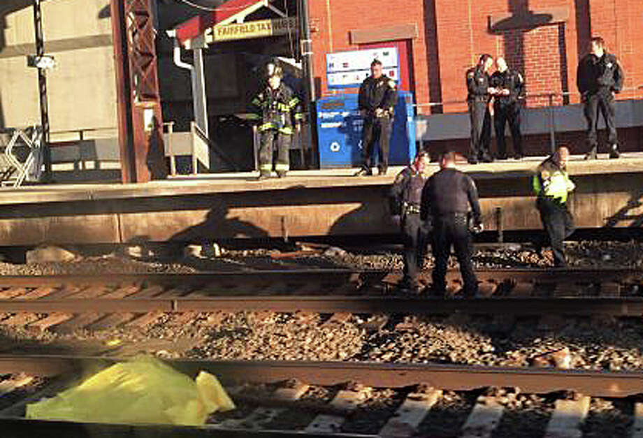 A passenger on a passing train took this picture of the scene at the Fairfield Railroad Station where a 31-year-old Waterbury woman was struck and killed by an Amtrak train Sunday evening. Photo: Amanda Corbesato. Photo: Contributed Photo / Fairfield Citizen