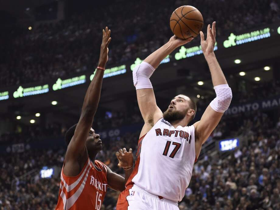 March 30: Raptors 99, Rockets 96Toronto Raptors' Jonas Valanciunas (17) shoots as Houston Rockets' Clint Capela defends during first half of an NBA basketball game in Toronto, Monday, March 30, 2015. (AP Photo/The Canadian Press, Frank Gunn) Photo: Frank Gunn, Associated Press