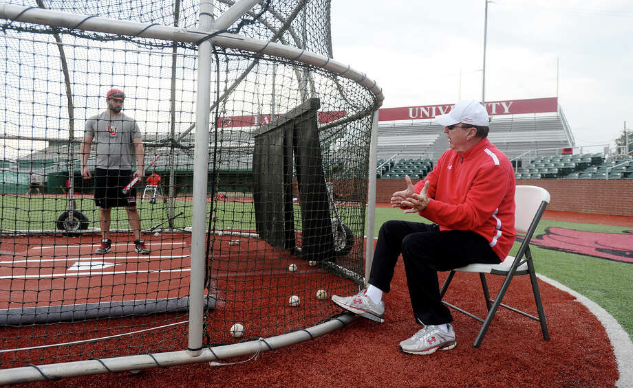 Tyler Sullivan, right, listens as Coach Jim Gilligan gives him tips on his swing during practice Wednesday. The Lamar Cardinals baseball team practiced at Vincent-Beck Stadium on Wednesday afternoon.