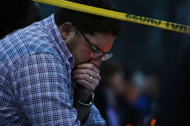 A man reflects during a candlelight vigil attended by hundreds at Jonathan Law High School after the death of Maren Sanchez, 16, who was stabbed to death Friday morning inside the school on April 28, 2014 in Milford, Connecticut. Sanchez, a popular student, was stabbed by a male student just hours before she was to attend her junior prom with her boyfriend. Photo: Spencer Platt, Getty Images
