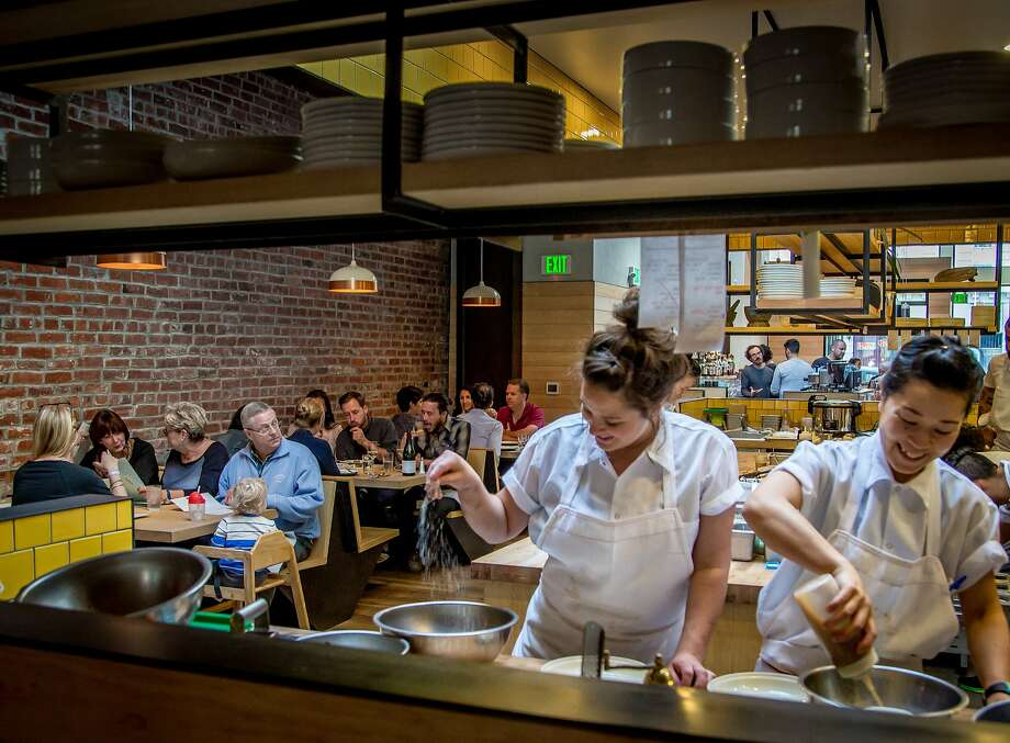 Diners have dinner next to the kitchen at Liholiho Yacht Club in San Francisco, Calif., on March 30th, 2015. Photo: John Storey, Special To The Chronicle