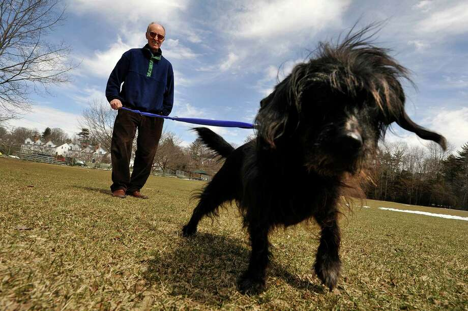 Mark Noonan, of Nootools, demonstrates his Leash Tamer invention with his dog, Nellie, at Mead Memorial Park in New Canaan, Conn., on Tuesday, March 24, 2015. Noonan says it is a hands-free, tangle free, multi-function dog leash that is designed to replace all leashes. Photo: Jason Rearick / Stamford Advocate