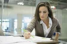 Businesswoman working at office desk