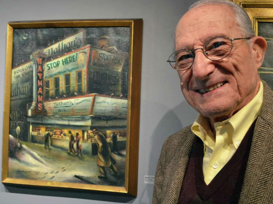 Leonard Everett Fisher syands next to a painting he did of the original Nathan's at Coney Island, N.Y., one of his works featured in a new Westport Arts Center retropsective of 70-year artistic career. Photo: Jarret Liotta / Westport News