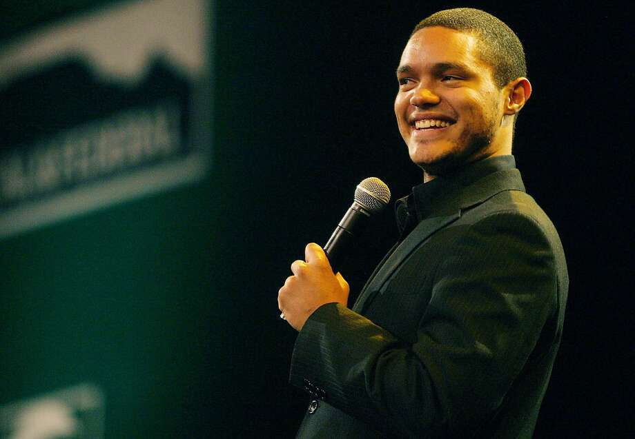 (FILES) A June 17, 2008 file photo shows South Africa Stand up comedian Trevor Noah performing at the SA cricket awards held at the Sandton convention centre in Johannesburg. Noah, who is not married and has been based in the US for about three years, is next due to perform live in South Africa for 15 concerts at the Teatro at Montecasino in Johannesburg between May 29 and June 28, 2015. AFP PHOTO/STRINGER-/AFP/Getty Images Photo: -, AFP / Getty Images