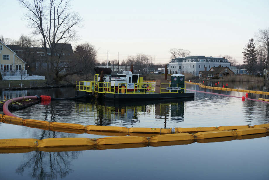 Dredging equipment has been moved into the waters just above the Tide Mill Dam, as part of the efforts to remove lead-contaminated soils from the Mill River. Photo: Genevieve Reilly / Fairfield Citizen
