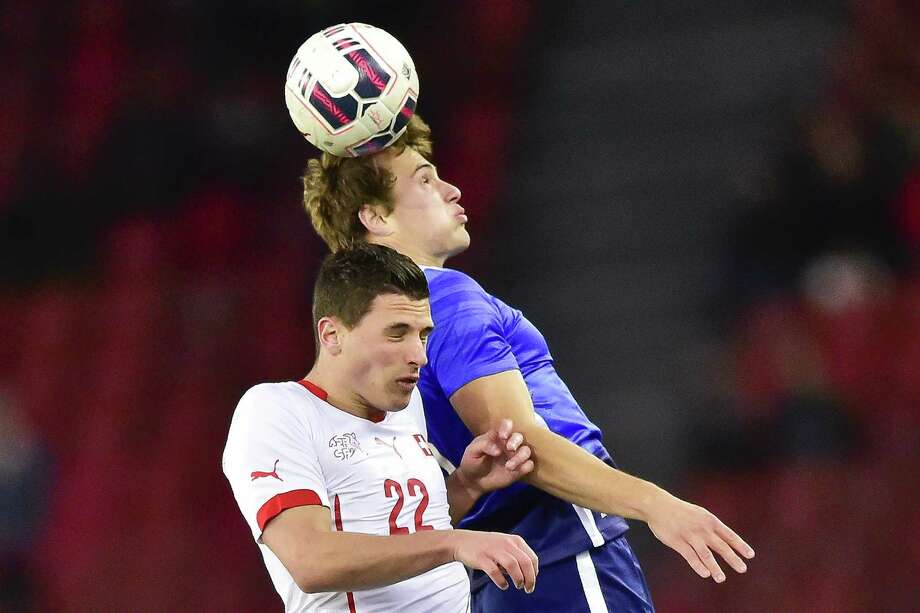 Switzerland's Fabian Schaer (left) fights for the ball with United States' Jordan Morris on March 31, 2015 during a friendly match in Zurich. Photo: Michael Huholzer / Getty Images / MICHAEL BUHOLZER