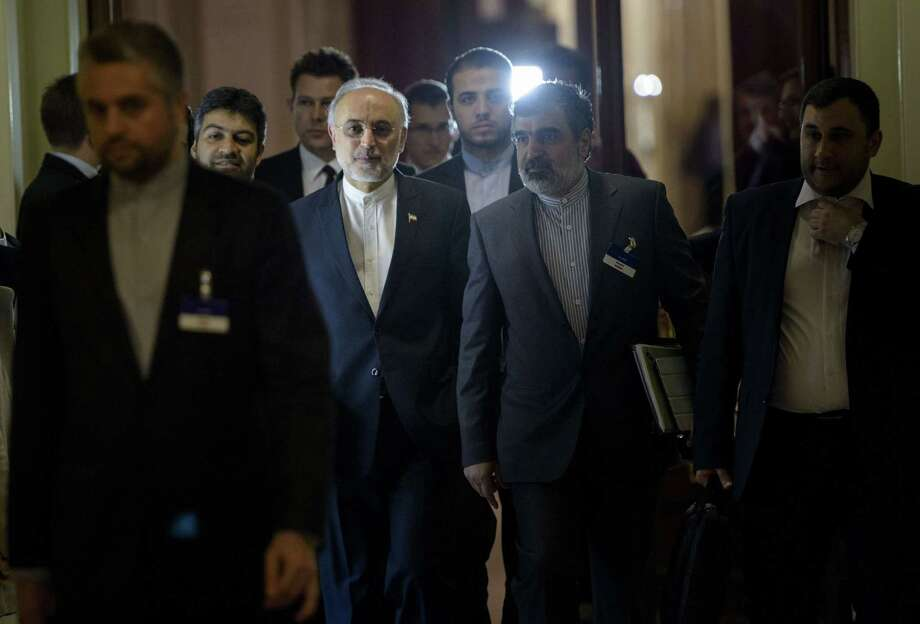 Head of Iranian Atomic Energy Organization Ali Akbar Salehi walks with others during a break in a meeting with world powers representatives seeking to pin down a nuclear deal with Iran in Lausanne. Photo: BRENDAN SMIALOWSKI / AFP / Getty Images / 2012 Brendan Smialowski