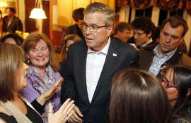 FILE - In this March 13, 2015 file photo, former Florida Gov. Jeb Bush speaks with area residents at a packed house party in Dover, N.H. Few states have shaped presidential politics like Iowa, New Hampshire and South Carolina. By hosting the nation's first presidential primary contests, the states have reaped political and financial rewards for decades on successful candidates and hastened the end for underachievers. Yet their clout may be declining in 2016. (AP Photo/Jim Cole)