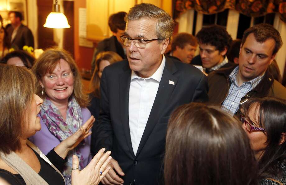 FILE - In this March 13, 2015 file photo, former Florida Gov. Jeb Bush speaks with area residents at a packed house party in Dover, N.H. Few states have shaped presidential politics like Iowa, New Hampshire and South Carolina. By hosting the nation's first presidential primary contests, the states have reaped political and financial rewards for decades on successful candidates and hastened the end for underachievers. Yet their clout may be declining in 2016. (AP Photo/Jim Cole) Photo: Jim Cole, Associated Press