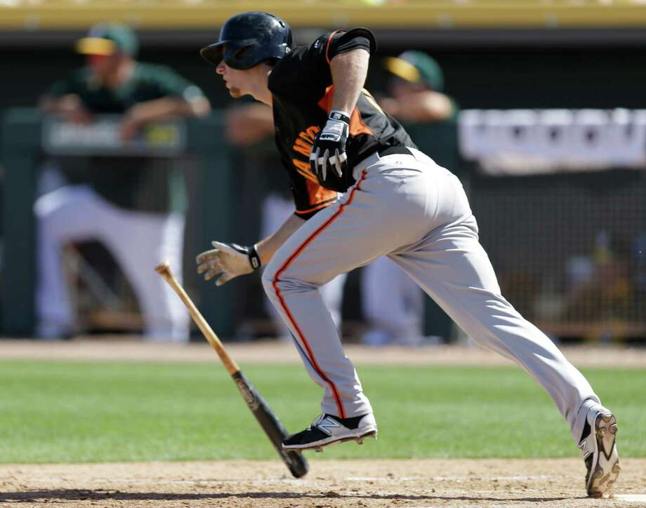 San Francisco Giants' Matt Duffy runs to first base after hitting a single off Oakland Athletics' Jesse Chavez in the third inning of a spring training exhibition baseball game Saturday, March 14, 2015, in Mesa, Ariz. (AP Photo/Ben Margot) Photo: Ben Margot / Associated Press / AP
