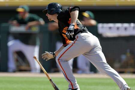 San Francisco Giants' Matt Duffy runs to first base after hitting a single off Oakland Athletics' Jesse Chavez in the third inning of a spring training exhibition baseball game Saturday, March 14, 2015, in Mesa, Ariz. (AP Photo/Ben Margot)