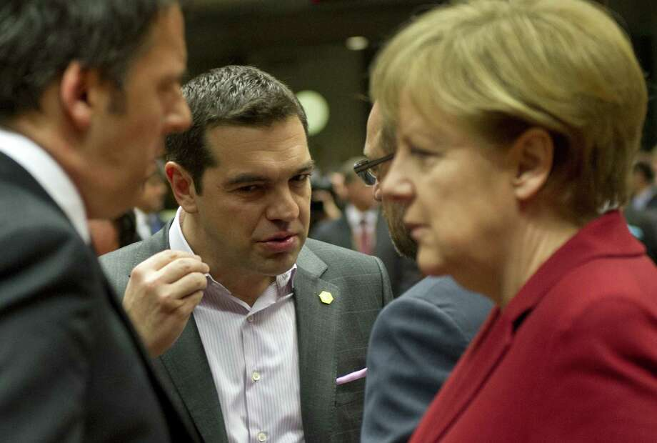 TOPSHOTS (From L) Italy's Prime minister Matteo Renzi, Greece's Prime minister Alexis Tsipras, European Parliament President Martin Schulz and Germany's Chancellor Angela Merkel talk before a working session during an European Council summit on March 19, 2015 at the Council of the European Union (EU) Justus Lipsius building in Brussels. European leaders meet for a two-day summit likely to be dominated by Greece's cash crunch and the question of whether to extend sanctions against Russia over the crisis in Ukraine.   AFP PHOTO / ALAIN JOCARDALAIN JOCARD/AFP/Getty Images Photo: ALAIN JOCARD / AFP / Getty Images / AFP