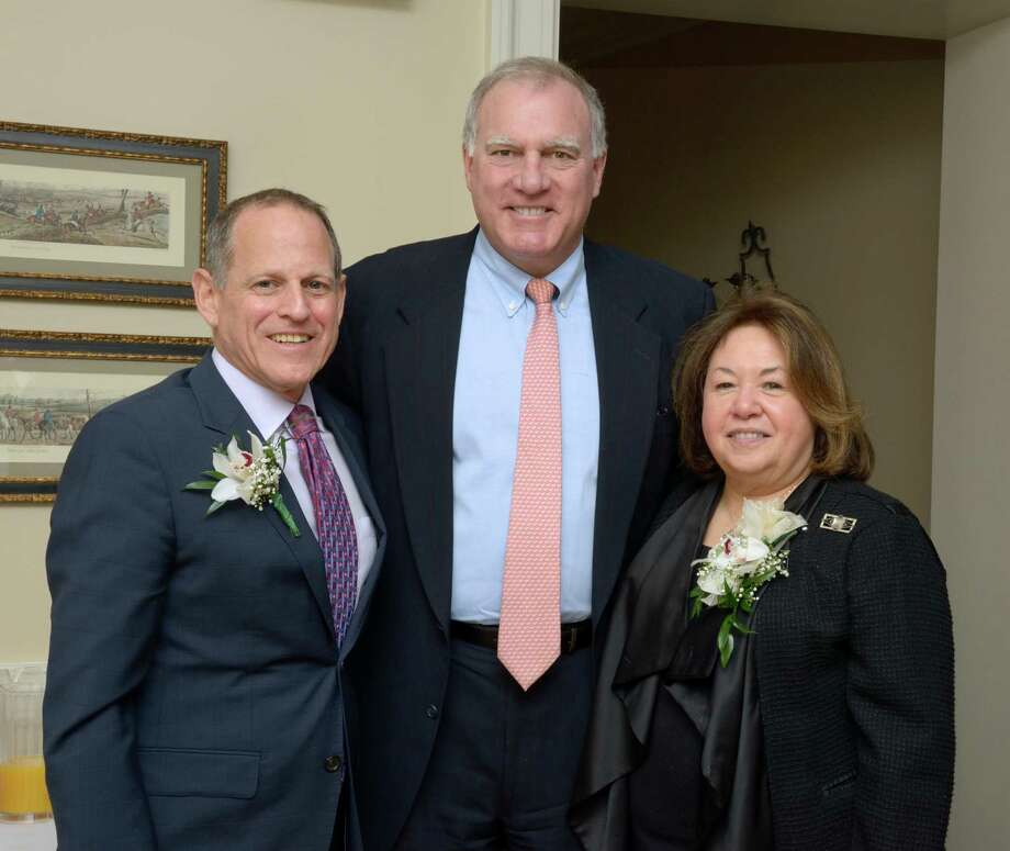 Democratic Town Committee award winners Steven Sheinberg, left, and Ruth Smey flank state Attorney General George Jepson, one of the state officials on hand for the DTC's annual Century Club Brunch at the Patterson Club. Fairfield CT. March 29, 2015. Photo: Fairfield Citizen/Contributed / Fairfield Citizen