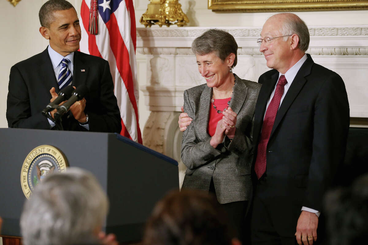 WASHINGTON, DC - FEBRUARY 06: REI Chief Executive Officer Sally Jewell (C) is congratulated by outgoing Interior Secrtary Ken Salazar after she was nominated by President Barack Obama to be the next Secretary of the Interior in the State Dining Room of the White House February 6, 2013 in Washington, DC. Jewell has been CEO of the huge outdoor retailer REI since 2005. (Photo by Chip Somodevilla/Getty Images)