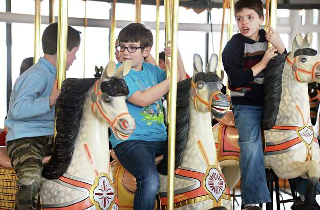 Riding the Merry-Go-Round at the State  Museum are, from left, Nick Palmer, 7, of Granhamsville, Sean Austin, 9, of Glenville and Aaron Blackwood, 9, of Glenville Tuesday March 31, 2015 in Albany, NY.   (John Carl D'Annibale / Times Union) Photo: John Carl D'Annibale