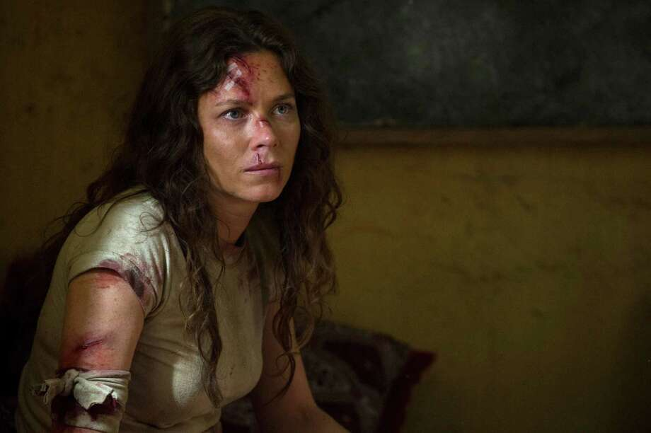 "Anna Friel portrays soldier Odelle Ballard is captured and beaten by terrorist groups, but realizes her worst enemy is a U.S. assassin in 'American Odyssey' on NBC. April, 2015 AMERICAN ODYSSEY -- Episode 101 ""Gone Elvis"" -- Pictured: Anna Friel as Odelle Ballard -- (Photo by: Virginia Sherwood/NBC) Photo: Virginia Sherwood, Contributor / NBC / 2014 NBCUniversal Media, LLC."