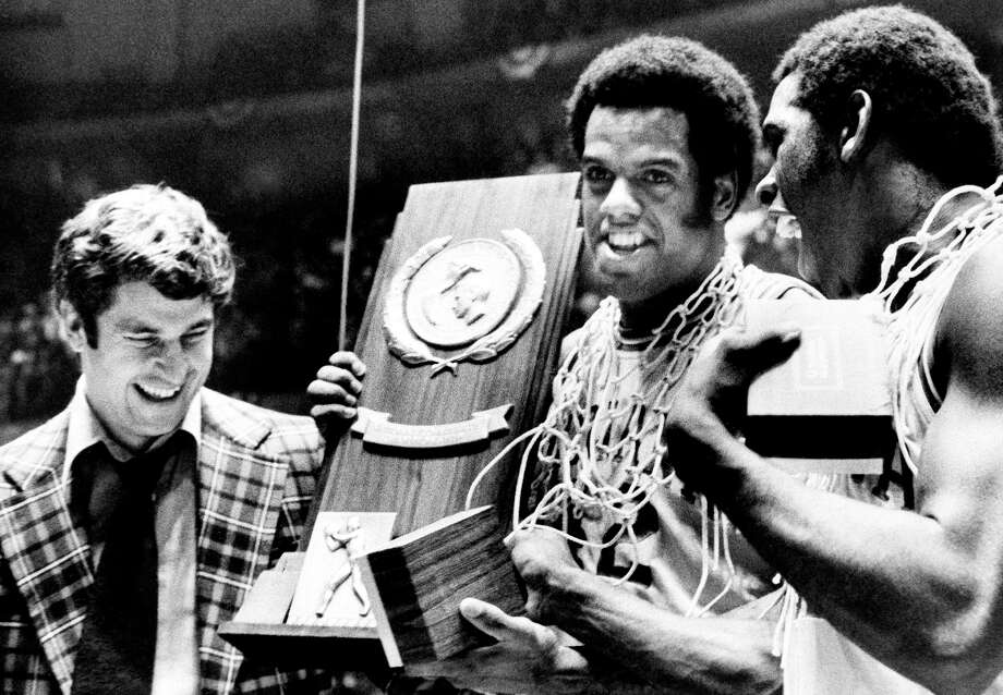 Scott May (center) and Quinn Buckner celebrate with coach Bobby Knight after Indiana completed its undefeated season by beating Michigan for the 1976 NCAA championship in Philadelphia. Photo: AP / Associated Press / AP