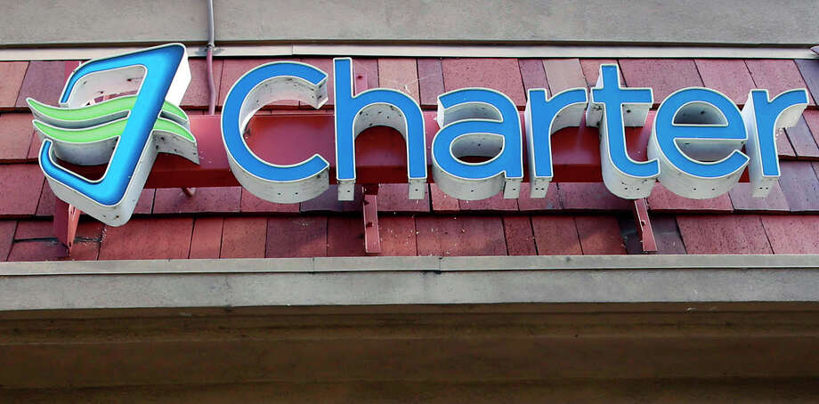 This Tuesday, March 31, 2015 photo shows signage at a Charter Communications facility in Glendale, Calif. Charter Communications Inc. is buying fellow cable operator Bright House Networks LLC in a deal valued at $10.4 billion. Charter is the fourth-largest cable operator in the U.S, while Bright House is the sixth biggest. (AP Photo/Nick Ut) Photo: Nick Ut, STF / AP