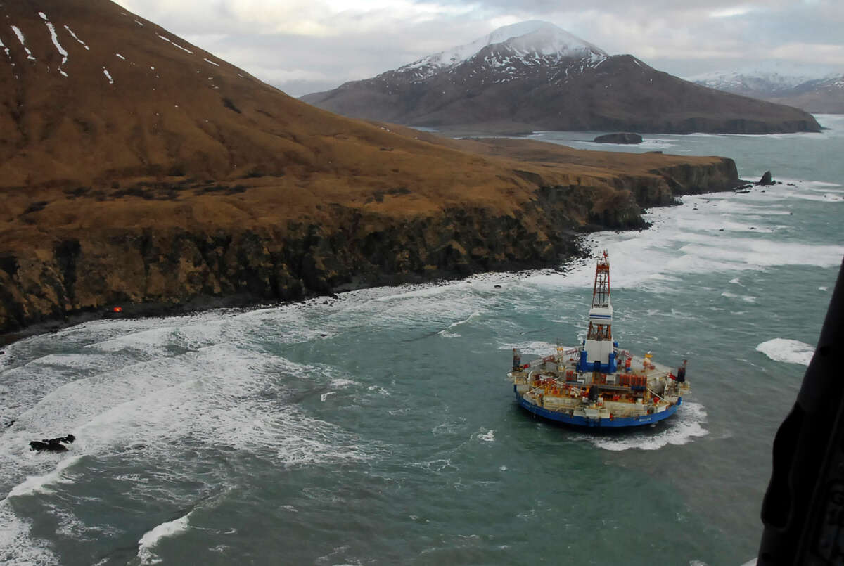 Two life rafts sit on a beach adjacent to a Royal Dutch Shell Oil drilling barge that ran aground in 2013, some 40 miles southwest of Kodiak City, Alaska.