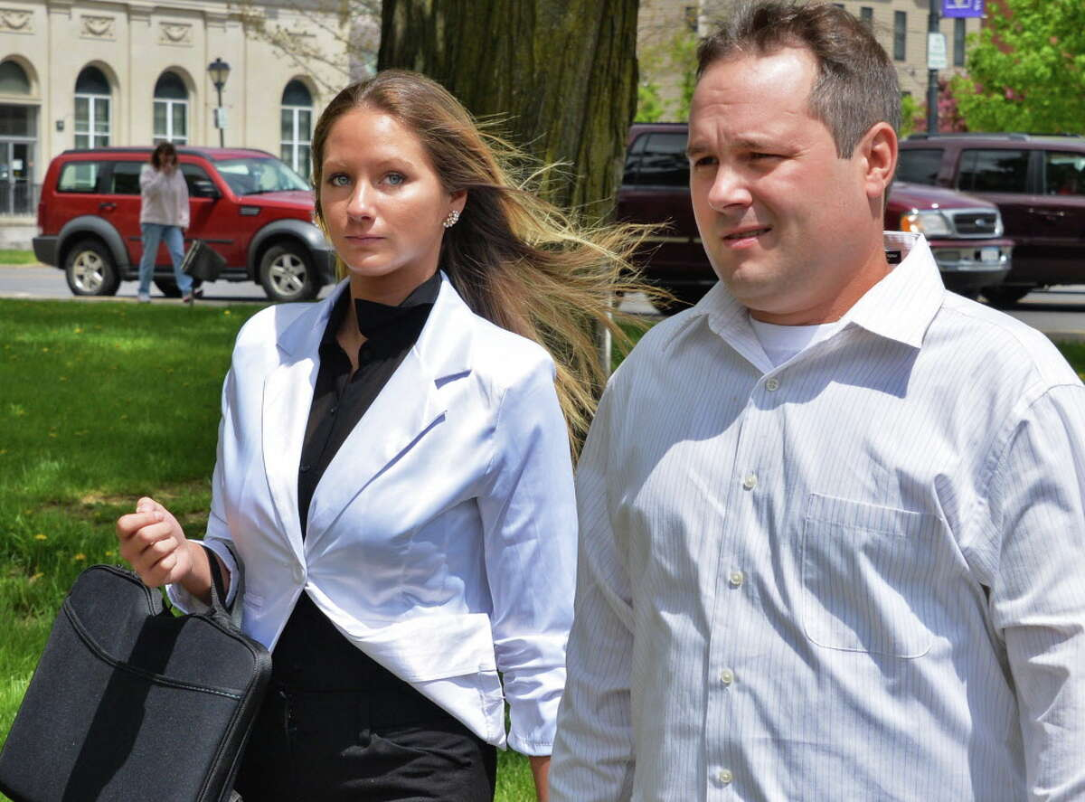 Sno Kone Joe owner Amanda Scott, left, and Joshua Malatino outside Fulton County Court House in Johnstown, NY Tuesday May 14, 2013. (John Carl D'Annibale / Times Union archive)