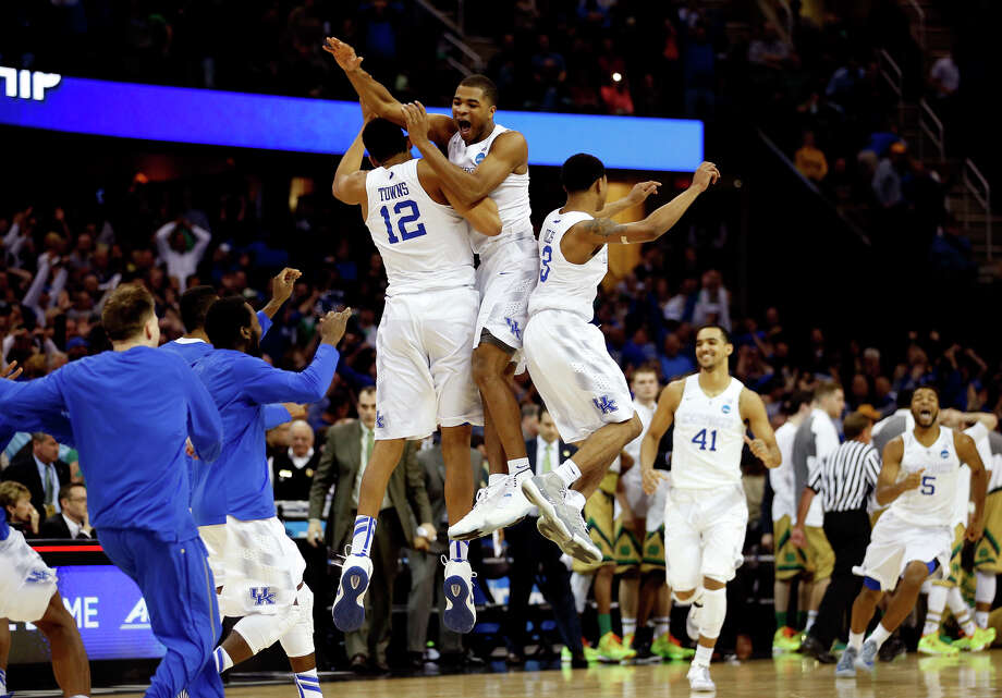 Kentucky players celebrate their two-point win over Notre Dame on Saturday in the Midwest Regional final. The Wildcats are two wins from an NCAA title and a perfect 40-0 season. Photo: Gregory Shamus / Getty Images / 2015 Getty Images