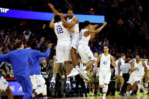 Kentucky players celebrate their two-point win over Notre Dame on Saturday in the Midwest Regional final. The Wildcats are two wins from an NCAA title and a perfect 40-0 season.