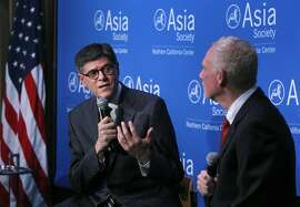 U.S. Secretary of the Treasury Jacob Lew (left) and N. Bruce Pickering, Vice President of Global Programs at the Asia Society, discuss Lew's recent trip to China in San Francisco, Calif. on Tuesday, March 31, 2015.