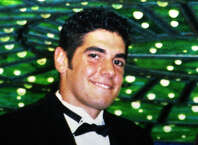 Mark Fisher, a former Fairfield University student athlete was killed in Brooklyn, N.Y. Lawyers for John Giuca, who was convicted of the 2003 killing, filed a motion asking a judge to vacate Giuca's murder conviction.